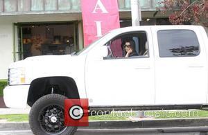 Kourtney Kardashian driving her truck in Beverly Hills Los Angeles, California - 07.04.11