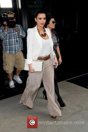 Kim Kardashian, Kourtney Kardashian and Manhattan Hotel
