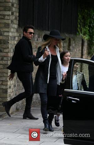Jamie Hince with new wife Kate Moss and her daughter Lila Rose enjoying a family day out London, England -...