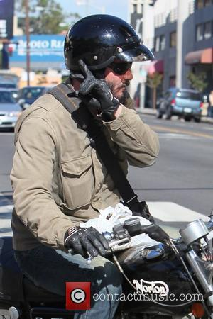 Keanu Reeves grabs a take away from Poquito Mass restaurant on his classic 1973 Norton Commando 750 motorcycyle Los Angeles,...