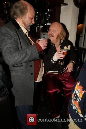 Keith Lemon and Rufus Hound disguised as two old bald men, enjoying a pint of beer at a pub, in...