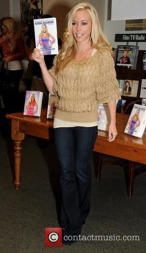 Kendra Wilkinson signs copies of her new book 'Being Kendra: Cribs, Cocktails, and Getting My Sexy Back' at Barnes &...