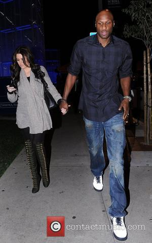 Lamar Odom and Khloe Kardashian hold hands as they leave a restaurant in Beverly Hills. Los Angeles, California - 26.01.11