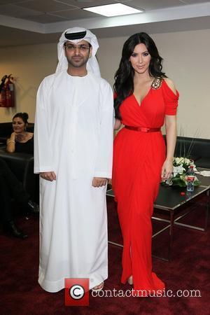 Kim Kardashian poses with Dubai and Abu Dhabi royals