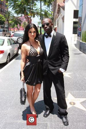 Kim Lee and Sam Sarpong are seen at Cafe Entourage in Hollywood Los Angeles, California - 20.06.11