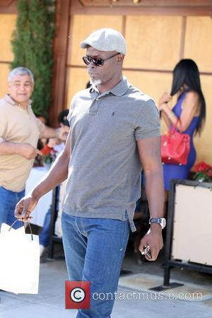 Djimon Hounsou and his wife have lunch at Il Pastaio Restaurant in Beverly Hills Los Angeles, California - 29.06.11