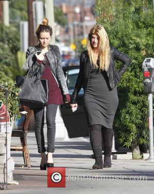 Kirstie Alley and daughter Lillie out and about in Los Angeles. Kirstie is wearing a cropped leather jacket and knee-high...