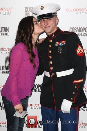 Lucy Hale kisses a U.S. Marine 3rd annual 'Kisses for the Troops' event on Veterans Day, held at Military Island,...
