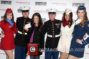 U.S. Marines, USO Girls, Lucy Hale 3rd annual 'Kisses for the Troops' event on Veterans Day, held at Military Island,...