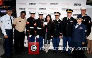 U.S. Service Men and Women and Lucy Hale 3rd annual 'Kisses for the Troops' event on Veterans Day, held at...