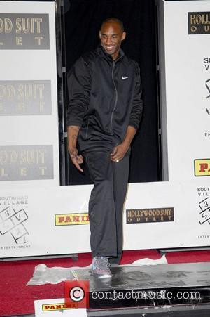 Los Angeles Lakers star, Kobe Bryant, attends a hand and footprint ceremony at the Grauman's Theater Los Angeles, California -...