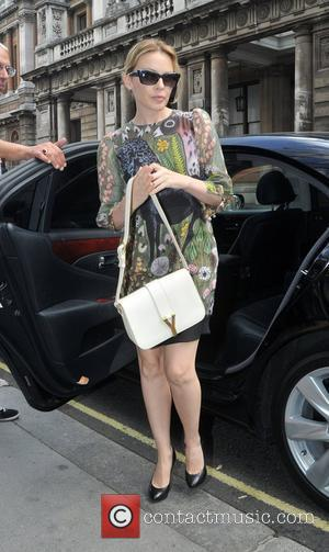 Kylie Minogue arriving at a restaurant London, England - 15.09.11