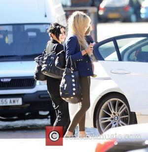 Kym Marsh and her daughter Polly leaving the 'Coronation Street' studios with Charley Webb and her son Buster. Kym hides...