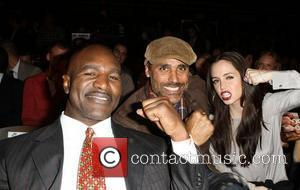 Evander Holyfield, Eliza Dushku and Rick Fox