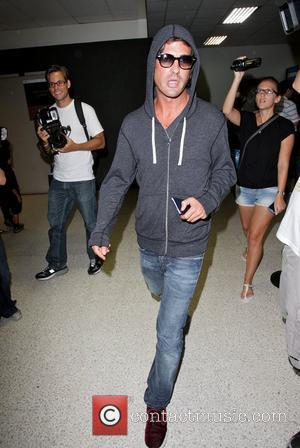 Brandon Davis arriving at LAX airport on a flight from Rome, after attending the wedding of Petra Ecclestone and James...