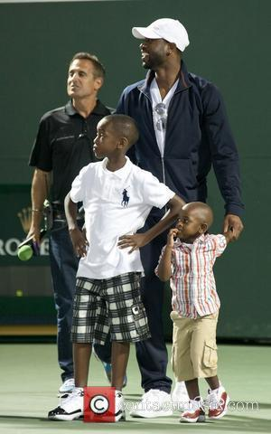 Miami Heat's Dwayne Wade and Lebron James do the coin toss before the 2011 Sony Ericsson Open at Crandon Park...