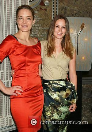 CEO DMKS Americas Katharina Harf and Leighton Meester Leighton Meester and Vera Wang light the Empire State Building red and...