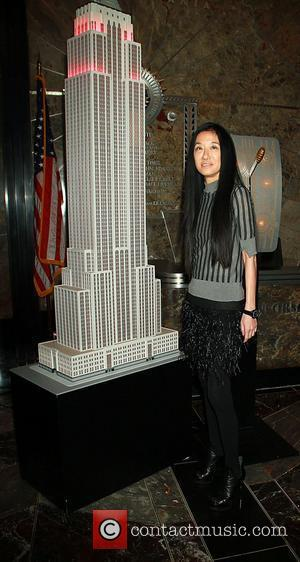 Vera Wang Leighton Meester and Vera Wang light the Empire State Building red and white in honor of the 5th...
