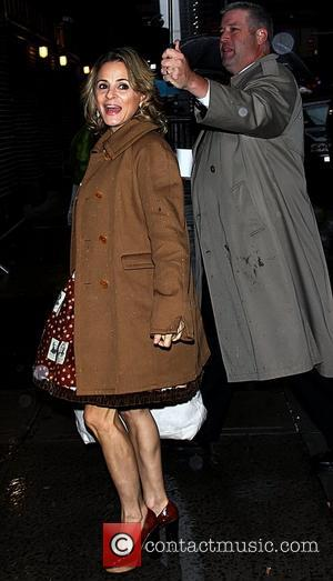 Amy Sedaris, being shielded from the rain by an assistant holding an umbrella 'The Late Show with David Letterman' at...