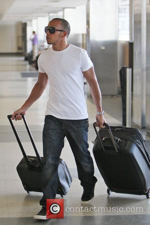 Lewis Hamilton seen arriving at LAX airport to catch a flight. Hamilton was more than likely heading to Spain where...