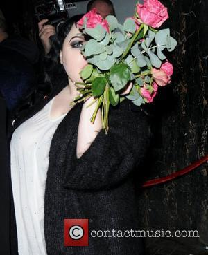 Beth Ditto hiding behind a bunch of flowers London Fashion Week A/W 2011 -AnOther Magazine Party - Departures London, England...