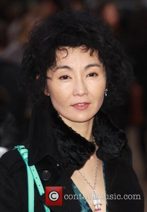 Maggie Cheung London Fashion Week A/W 2011 - Burberry Prorsum - Arrivals held at the Kensington Gardens London, England -...