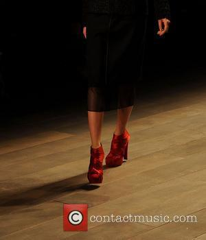 Model wearing the same shoes as Charlotte Dellal on the front row London Fashion Week A/W 2011 - Emilio de...