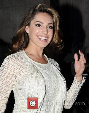 Kelly Brook London Fashion Week Spring/Summer 2012 - Giles Deacon - Outside London, England - 19.09.11