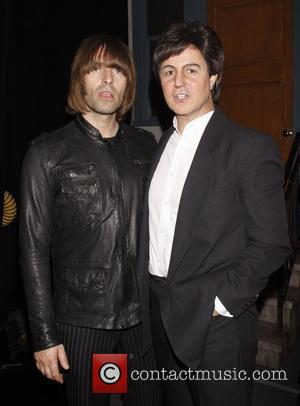 Liam Gallagher and Rain cast member Joey Curatolo Liam Gallagher and his band Beady Eye visit the cast of the...