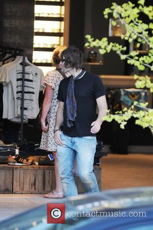 Beady Eye frontman Liam Gallagher is seen standing outside a shop in Toronto Toronto, Canada - 30.08.11