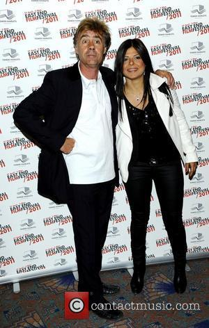 Glen Matlock (Sex Pistols) and female companion attend the East End Film Festival for the World Premiere of 'The Libertines...