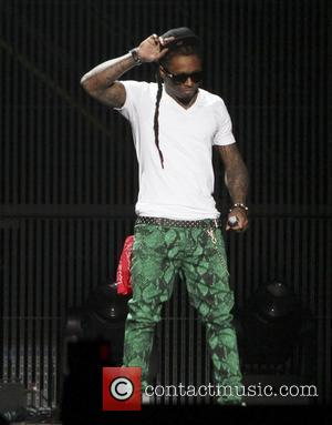 Lil Wayne  Lil Wayne performs during his ' I Am Still Music' Tour at the Nassau Coliseum in Long...