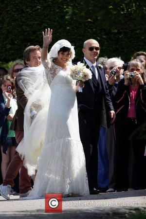 Lily Allen arriving with father Keith Allen  The wedding of Lily Allen and Sam Cooper Cranham, Gloucestershire - 11.06.11