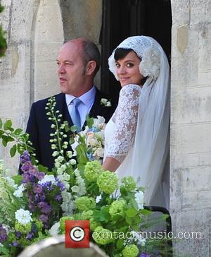 Lily Allen, alongside her father Keith Allen, arriving for her wedding to Sam Cooper Cranham, Gloucestershire - 11.06.11
