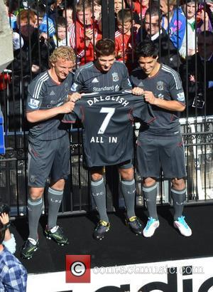 Liverpool FC players Steven Gerrard, Dirk Kuyt, and Luis Suarez brings Henry Street to a standstill as the team launch...