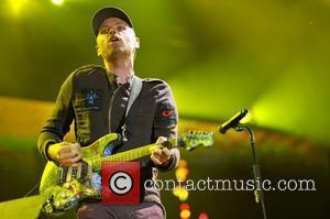Jonny Buckland of Coldplay Lollapalooza Music Festival 2011 - Performances - Day 1 Chicago, Illinois - 05.08.11