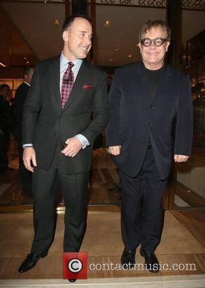 David Furnish, Bond, Elton John and Louis Vuitton
