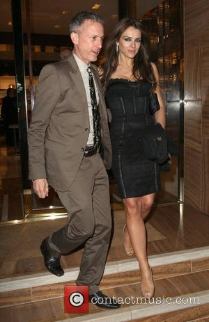 Patrick Cox and Elizabeth Hurley,  at a private dinner for the Elton John Aids Foundation held at Louis Vuitton...
