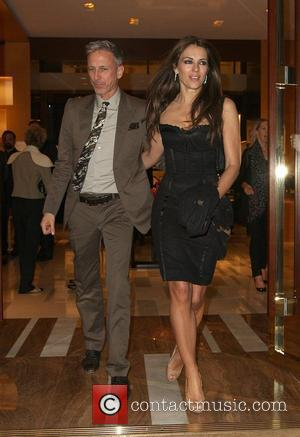 Patrick Cox, Bond, Elizabeth Hurley, Elton John and Louis Vuitton