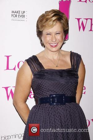 Yeardley Smith (voice of Lisa Simpson from The Simpsons, wearing shoes of her own design) After party celebrating the new...