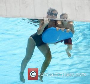 Lynne Spears and Jayden James Federline Lynne Spears plays in a pool with her grandchildren Dallas, Texas – 11.07.11