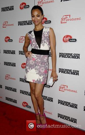 Zoe Saldana,  at the 'Machine Gun Preacher' premiere shown at the Academy of Television Arts & Sciences - Arrivals...