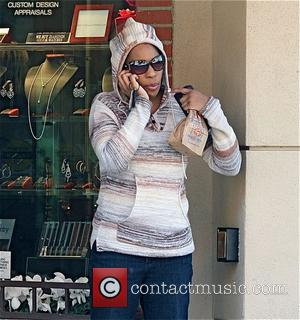 Macy Gray talking on her cellphone after leaving a medical building in Beverly Hills. Los Angeles, California - 27.01.11,