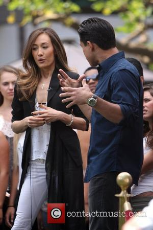 Maggie Q is seen on 'Extra' with Mario Lopez at The Grove in Hollywood Los Angeles, California - 10.05.11