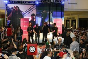 Mexican Latin rock band Mana sign copies of their new album 'Drama y Luz' at Plaza Las Americas Shopping Mall...