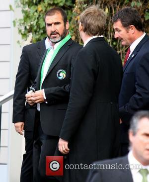 Eric Cantona leaving his the Lowry Hotel to watch the Manchester United vs New York Cosmos football match Manchester, England...