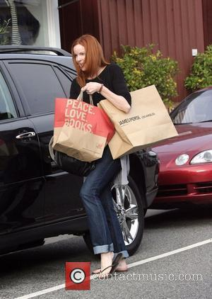 Marcia Cross returns to her car after shopping at The Brentwood Country Mart Los Angeles, California - 23.06.11