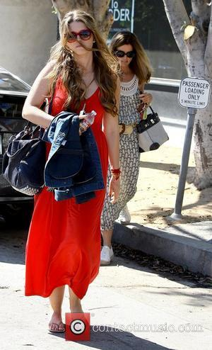Katherine Schwarzenegger and Maria Shriver returning to their cars after shopping together on Melrose Place in West Hollywood Los Angeles,...