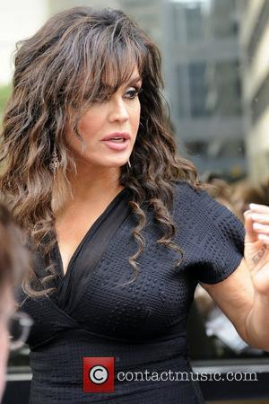 Marie Osmond greets fans as she leaves the Four Seasons Centre for Performance Arts after her 'Donny & Marie' show....