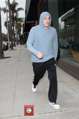 Mark McGrath wearing his sweatshirt hood while shopping in Beverly Hills Los Angeles, California - 25.02.11